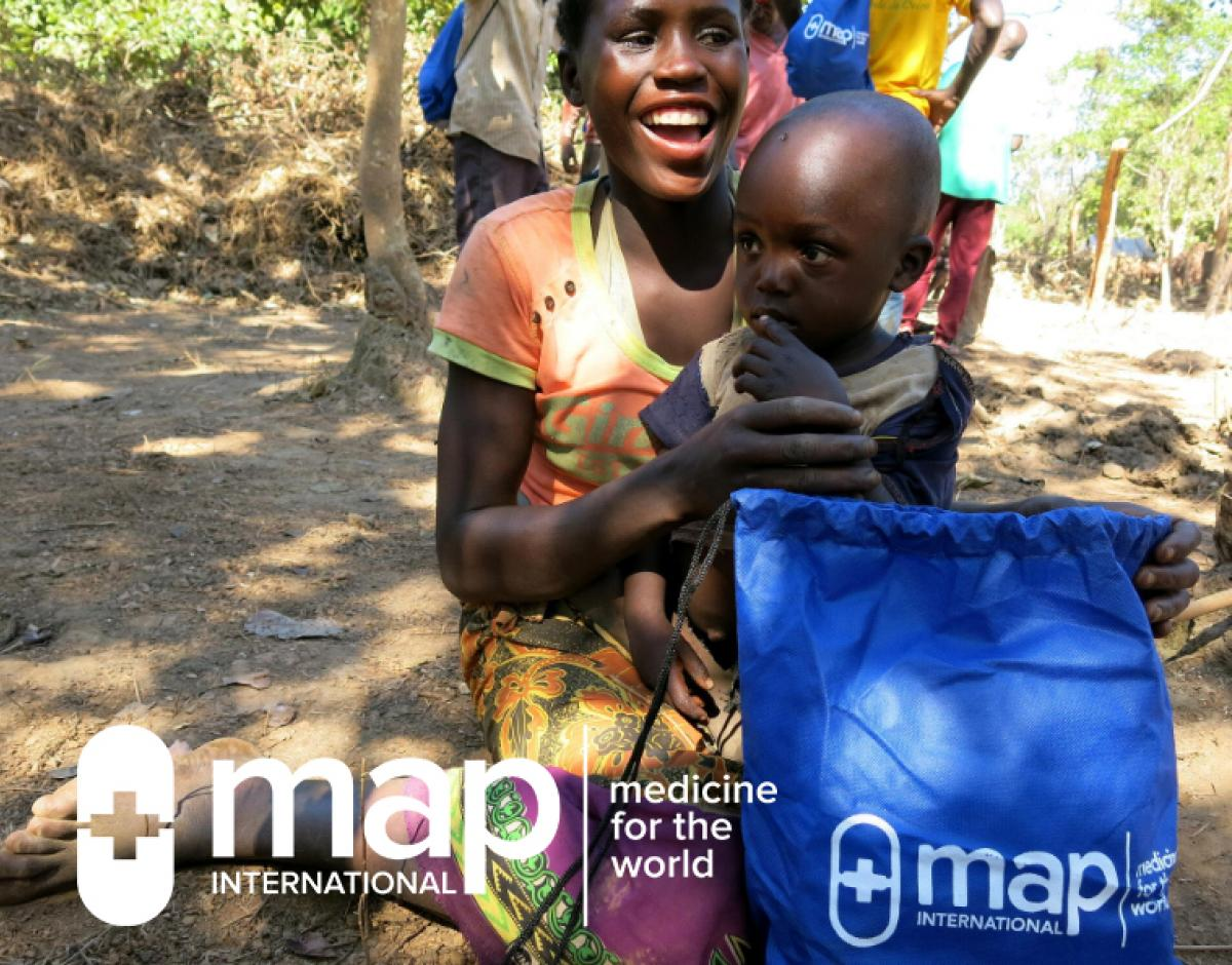 A woman and child with a MAP International Disaster Health Kit.