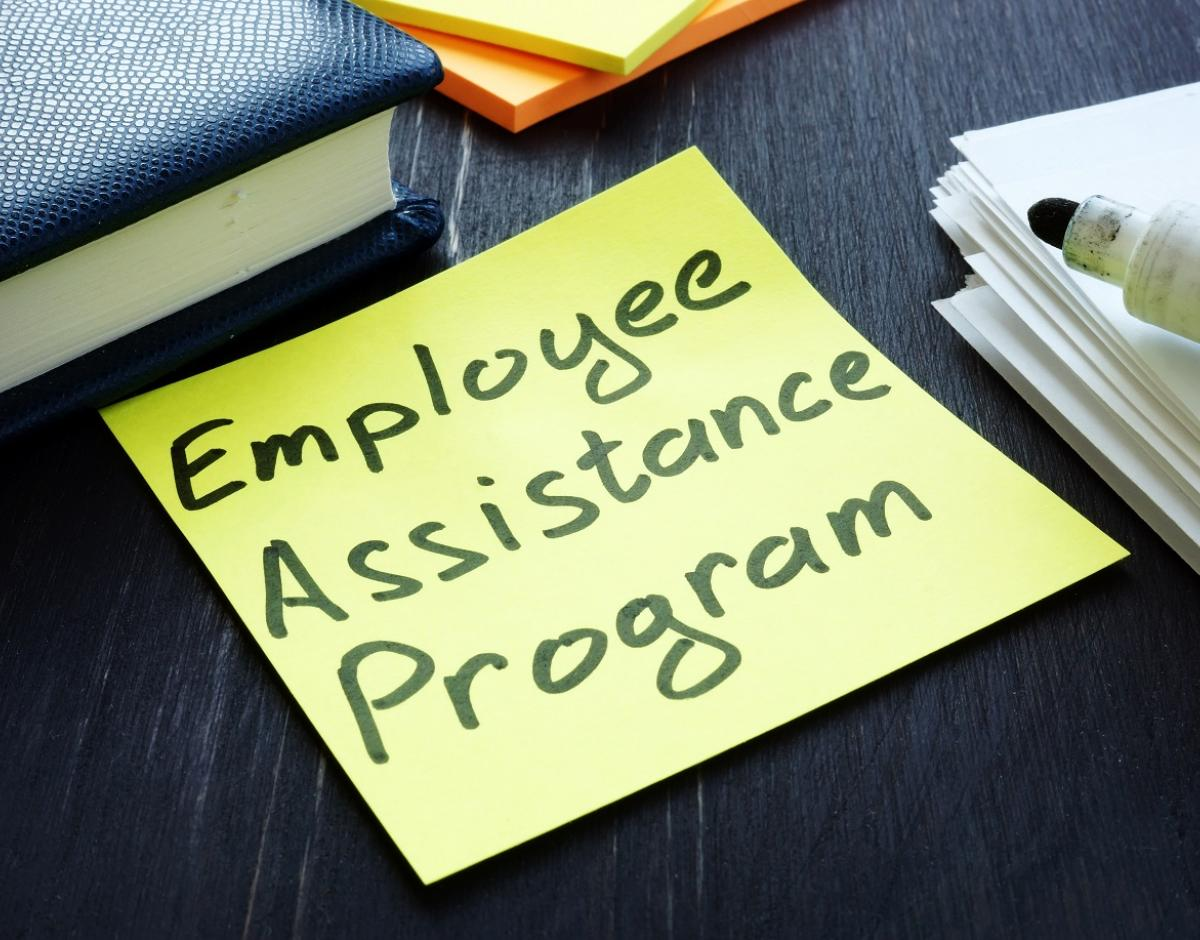 "Yellow sticky note reading ""Employee Assistance Program."""