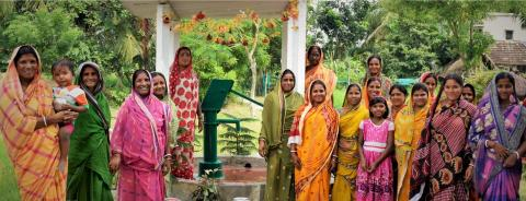 Women at community handpump
