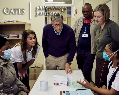 Bill Gates talking with health professionals.