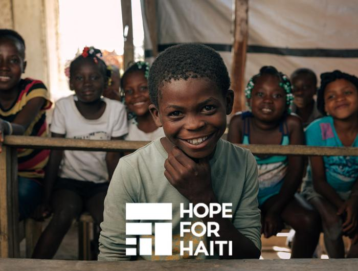 A boy sitting in a classroom in Haiti