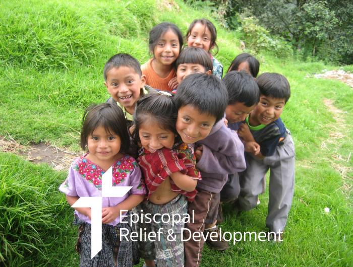 Children in Guatemala smile at the camera.