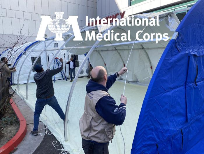 International Medical Corps workers setting up tents in front of the Martin Luther King, Jr. Community Hospital.