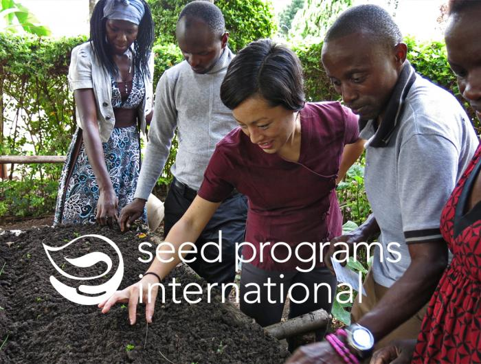 Five people testing seeds before distribution.
