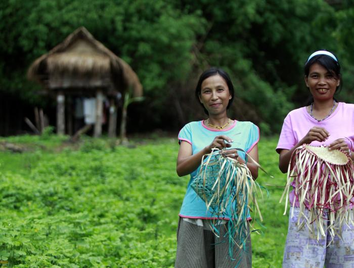 Mangyan women using livelihood skills to weave baskets