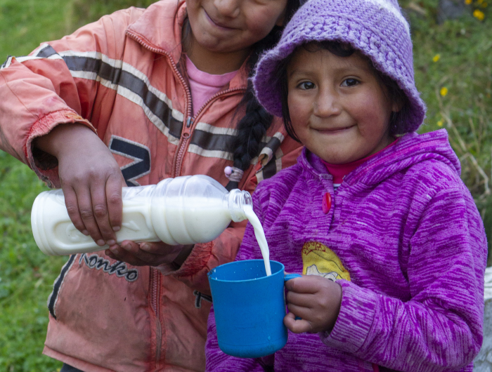 Mercedes and Catota with a cup of milk, Ecuador