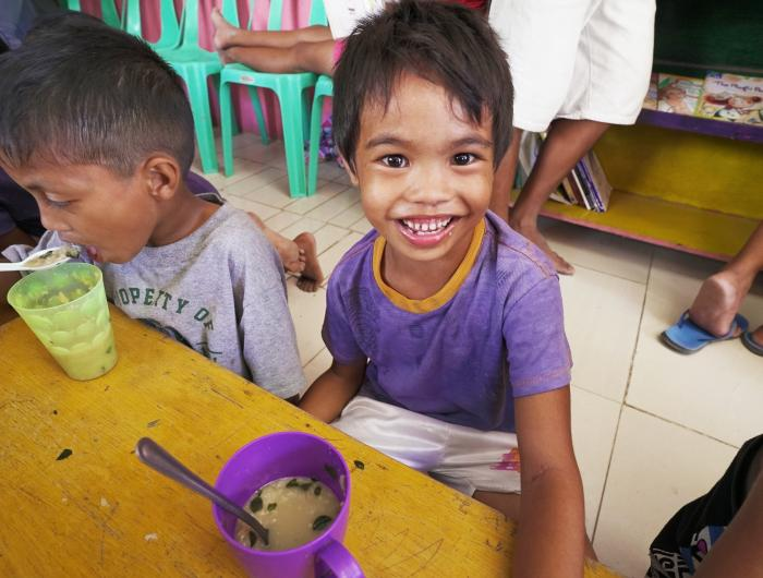 Child Eating FMSC Meals in the Philippines