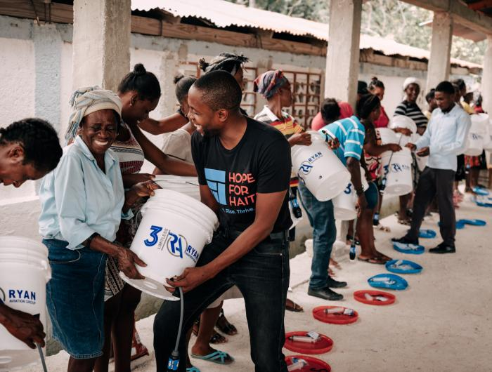 Distributing water filtration systems to a community