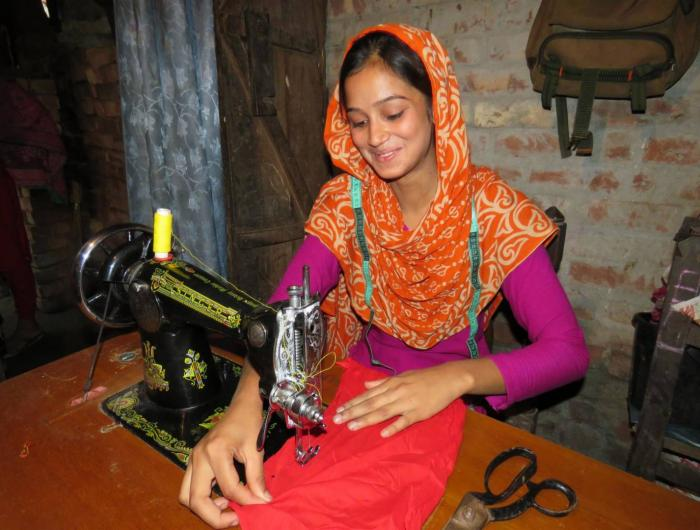 Tania works on her sewing machine World Vision provided