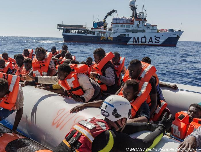 Migrants assisted by the MOAS rescue team