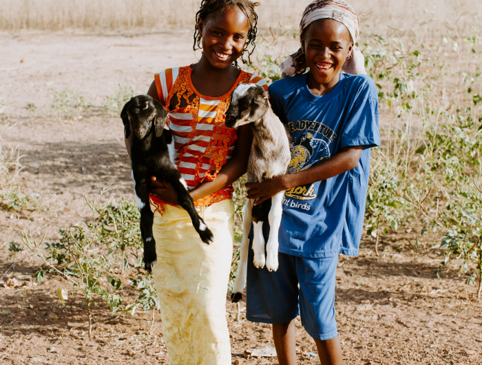 Tedy and Faty hold their 'kids' in Senegal.