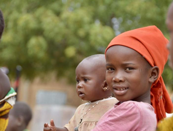 A girl and baby in the Fouta