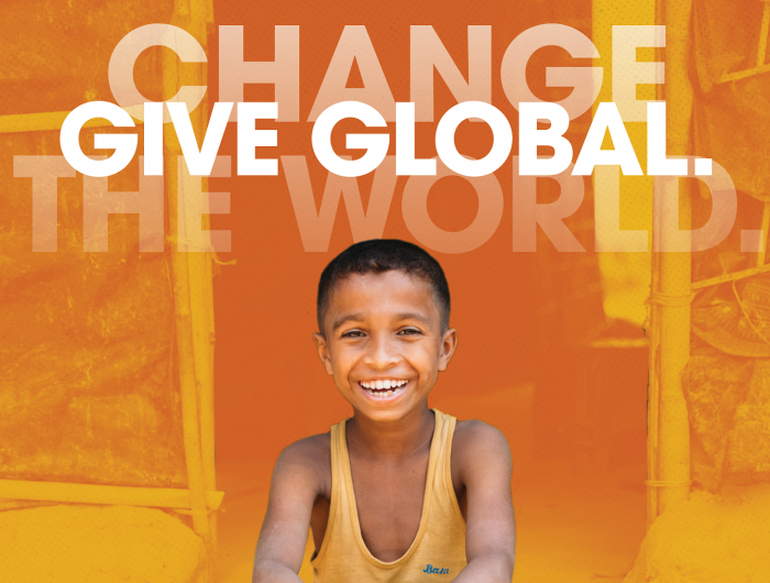 smiling boy with text Change the World. Give Global.